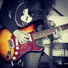 playing guitar .