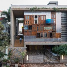 Reclaimed+windows+and+doors+form+facades+of+Collage+House+by+S+PS+Architects