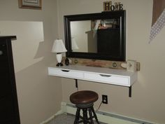 Space saving vanity using Ikea's Ekby shelf. Used an old antique level to hold the mirror, topped it all off with an antique piano stool.