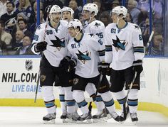 The San Jose Sharks are all smiles after a goal by forward Tyler Kennedy (Nov. 13, 2014).