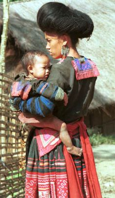Red Hmong woman and child in a village in Lai Chau province, northern Vietnam | Bright colour pleated skirt | spectacular hairstyles