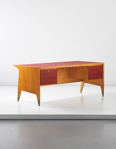 GIO PONTI Executive desk, 1950s  Walnut-veneered wood, painted wood, brass. 30 1/2 x 74 7/8 x 35 1/2 in. (77.5 x 190.2 x 90.2 cm) Together with a certificate of authenticity from the Gio Ponti Archives.