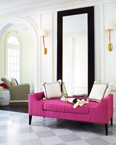 Entry/Foyer - Large black framed mirror with a vivid magenta pink settee - a beautiful & vibrant welcome.