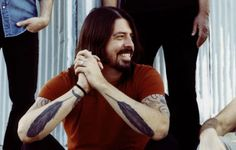 dave grohl feather tattoo