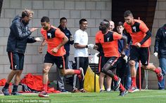 Sadio Mane (second right) is put through his paces as Liverpool returned to training at Me...