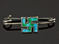 A silver and enamel brooch with a swastika at the centre, by Charles Horner, 1923; in 1923, the swastika had no Nazi connotations, and was considered a lucky symbol in the West. (Parade Antiques)