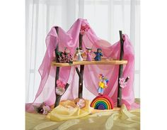 Make this simple play shelf and use different silks for different seasons...