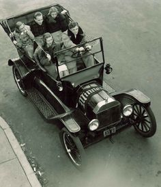 Students driving to the 1927 University of Minnesota Homecoming game in a Model T.