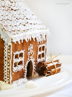 beautiful gingerbread house-love the cinnamon sticks stacked up as logs!