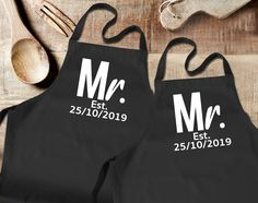 Gay couple Mr and Mr black aprons set. His and His set, with custom wedding date and surname or surnames. Newly weds, Husbands by SoulGoldTees on Etsy Black Apron, White Apron, Boy 16th Birthday, Bbq King, Daddy And Son, New Baby Announcements, First Fathers Day, Great T Shirts, Gay Couple