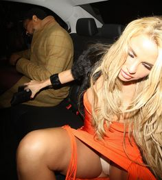 Katie Price Lookbook: Katie Price wearing Bandage Dress (1 of 21). Katie Price wore a bright orange bandage dress with fun fringe for her night out in London.