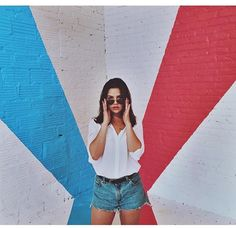 Danielle Campbel super cool effortless hairstyle with shorts and a button down shirt