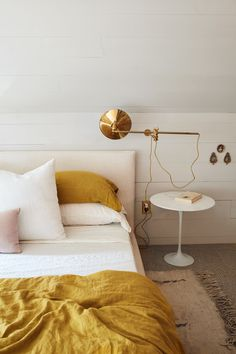 At home in Hudson with Hawkins New York (and their mustard-colored sheets) © Pippa Drummond