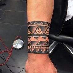 Top 63 Armband Tattoo Ideas [2020 Inspiration Guide] Tribal Wrist Tattoos, Simple Armband Tattoos, Tribal Armband Tattoo, Wrist Band Tattoo, Cuff Tattoo, Armband Tattoo Design, Wrist Tattoos For Guys, Cool Forearm Tattoos, Leg Tattoos