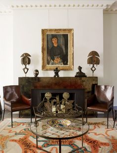 Leather Jean-Michel Frank chairs flank the custom-made mica mantel in a London sitting room by Jacques Grange. The portrait is by Amedeo Modigliani. The serpentine bronze bench is by Claude and François-Xavier Lalanne, and the cocktail table is by Jean Royère.