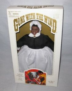 """Gone with the Wind MAMMY Doll by World Dolls 1989 by World Doll. $80.00. By World Doll and from the Portrait Doll Collection from the Original Screenplay.. Mammy (#61061) stands around 12"""" tall. Authentically dressed as in the movie.. A Limited Edition Collectible Doll. Display Stand Included. Mammy is wearing a black dress with a white apron, collar, and bandana on her head. Also, her red silk petticoat!"""