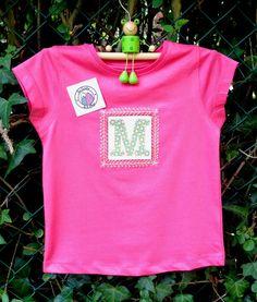 """Camiseta """"M"""""""