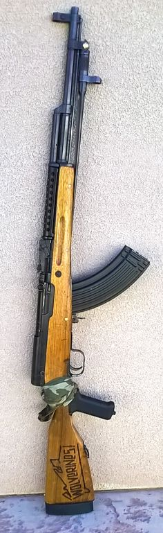 everythingsks:  Insurgent's Rifle final  The stock on my SKS D cracked so I modified it with a pistol grip. I also made a feedramp and polished the chamber, replaced the chipped wood top guard with a steel ventilated one, modified the safety so it did not dig into my finger, fixed the crack which is under the bandana and ran 90 rounds through it today with zero hiccups. The grip may look goofy but it works great.