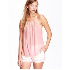 "Old Navy Sz XL Peach Carnation Adjustable Tank Top Rounded high neck with pleats.  Adjustable halter straps; racer back.  Hi lo hem with side vents.  Smooth. lightweight crepe.  Fitted through body.  Tanks hits below waist.   Bust 38-40 Length 27""  New With Tags! Retails for $19.94  Old Navy Tops Tank Tops"