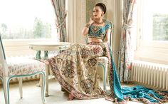 Gold tissue silk bridal lengha with maroon patchwork and turquoise blue blouse