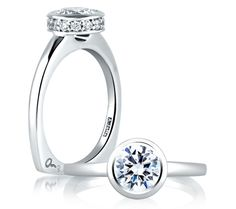 THIS IS THE EXACT RING!!!!!! <3 <3 <3   A. Jaffe - Designer..... Round Halo Bezel Center Set Engagement Ring @ameliachastine