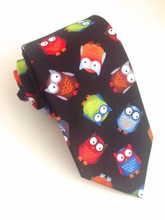 Colourful Owl Tie  #VanBuck #Tie #NeckTie #Ties #Owls #AnimalLover #OwlLover #Bird #Novelty #Colourful #Accessories #MensAccessories   http://www.fabties.com/ties/novelty-ties/colourful-owl-tie.html