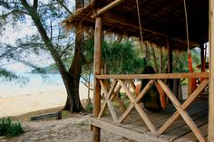 Lazy Beach, Cambodia:  $20 round-trip boat ride.  takes two hours from Ochheuteal Beach, which itself is in Sihanoukville, about three hours from Phnom Penh by a $5 bus.  That said, this is a beach you go to and stay for a few days.  clean bungalows for $60 a night, complete with hammocks for (you guessed it!) lazing about