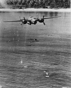 "B-25 Mitchell bomber of the 405th Bomb Squadron ""Green Dragons"" employing the skip-bombing technique against enemy shipping, southwest Pacific, 1944-45."