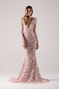 Blush sequin mermaid gown with plunge neck & strong shoulders.-Michael Costello US Size Chart- Made true to size- Include inchesof yourheels to your height- If you select custom, one of our representatives will contact you for size information- Dry clean only