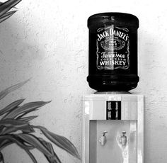 Jack Daniels Watercooler Moet cooler...what a genius idea for a laid back reception or bachelor/bachelorette party or any kind of adult party!