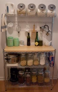 Baker's Rack for additional counter space and pantry shelving. Also, good use of mason jars. http://www.kitchensource.com/bakers-racks/df-ksh402.htm