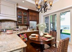 beachfront kitchen with banquette - Traditional Kitchens - Kitchens.com