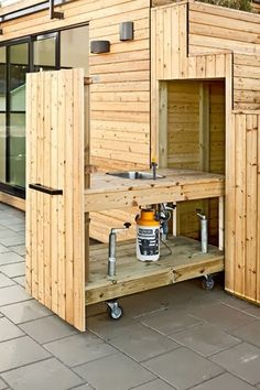 This shed packs it all in -- workspace, guesthouse, storage, seating, rooftop terrace and even a concealed kitchen. Small Outdoor Kitchens, Outdoor Spaces, Outdoor Living, Garden Office, Rooftop Terrace, Pergola Plans, Architecture, Shed, Home And Garden