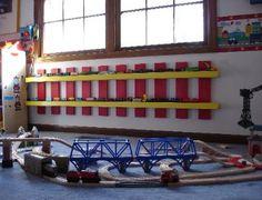 Love the train display.what a cute way to store trains! Boys Train Room, Train Bedroom, Big Boy Bedrooms, Kids Bedroom, Bedroom Ideas, Transportation Room, Thomas Bedroom, Toy Rooms, Bedroom Storage
