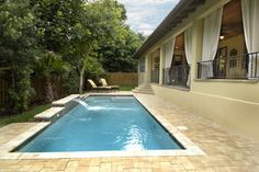 For small backyard space...Poolside Lanai - tropical - exterior - tampa - Gritton & Associates Architects