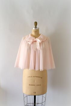 Lovely 1905s pale pink bed jacket.  This is very similar to the one my mom had, that she gave me, except that hers had sleeves and was quilted, and also the bow was thin, not big.