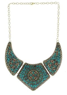 Brass Necklace displays lovely mandala pattern mosaic. The mosaic is made up of colorful turquoise and red coral stones. This piece comes from India. [$28.80]