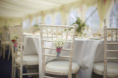 Limewash Chiavari chairs used with flower decorations to fit the wedding theme