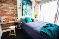 Love brick and panel wall with art piece ... Plus wooden board instead of bed side table
