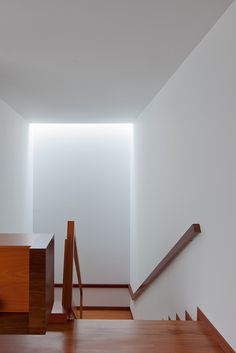 Soft light enetering the staircase inside the AADD House by Helder de Carvalho.