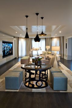 this room balances both masculine and feminine by creating several different functional seating areas, guest can get right up close and personal to the TV while those not watching television can gather elsewhere and chat.