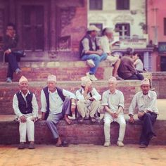 Scene from sunny Durbar Sq in #Patan today. Their topic of conversation echoing countless others throughout the region: when will this year's #monsoon rains start to fall?