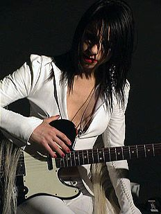 PJ Harvey...ooohh a girl with an electric guitar.