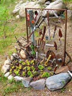 wire old garden tools on a gate and use as.trellis our accent piece  Very cool!