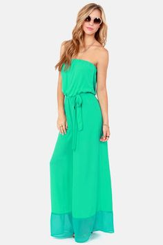 Check it out from Lulus.com! Nothing will put you hot on your heels like the Twinkle Toes Strapless Sea Green Jumpsuit! This woven green jumpsuit is just begging for a hot pair of heels to showcase below the teal-blue trimmed wide-leg pants, while a billowy strapless bodice keeps it cool up top. Cinched elastic waistband is topped by a matching belted sash. Lined to mid-thigh. Model is wearing a size small. 100��0Polyester. Dry Clean Only. Made with Love in the U.S.A.