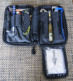 My EDC tool kit (Condor Pocket Pouch). Contents: American Medical Kits Pocket Survival Pak, Gerber multi tool, Multi 11-1 survival tool, 6 zip ties, Bic lighter, Streamlight Microlight 1A, 4 1A batteries, Gerber Guardian folding knife, Precision Screwdriver Set - 9 Pc; Torx, Phillips, eye glass repair kit and replacement screws, black paracord - 12', MII can opener, razor blade, EESE AH-1 arrowhead, Precision oil pen, mini vise grips, mini pry bar, Leatherman Skeletool and 5 pc blade kit.