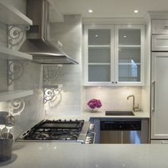 Elegance in the kitchen achieved with Cancos Tile and Stone.