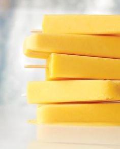 Creamy Orange Pops Recipe ~ Orange juice concentrate + yogurt = Deliciousness! You can also make these pops in small disposable paper cups -- simply peel away the paper to unmold.