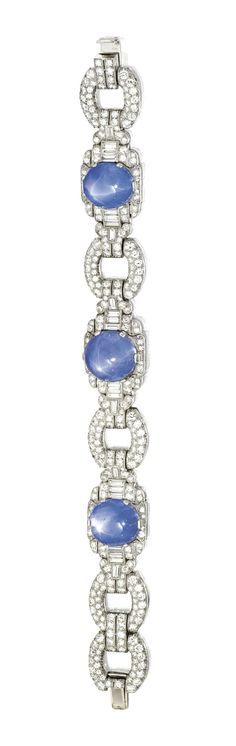 PLATINUM, STAR SAPPHIRE AND DIAMOND BRACELET, CIRCA 1930. Set with oval cabochon star sapphires weighing approximately 50.00 carats, accented by round and baguette diamonds weighing approximately 9.25 carats, length 6¾ inches, numbered 15282.