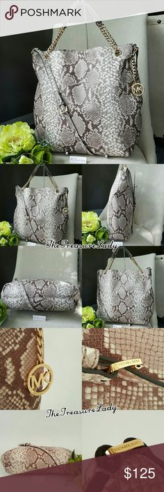 """Michael Kors Jet Set Chain Shoulder Tote Purse bag Store display - hardware has some scratches True color on 1st & 2nd pics *Authentic *NWT *Style # 35S6GTCE3E *Large Jet Set Chain Shoulder Tote *Dark sand color with python/snake print *100% embossed leather *Gold-tone hardware *Magnetic snap closure *Detachable MK emblem *Measurements: 14"""" H x 16"""" L x 3.25"""" D *6.5"""" handles + a long adjustable shoulder strap *Inside slip(4) & zip (1)pockets *UPC 190049113950  Please no trades, price is firm…"""